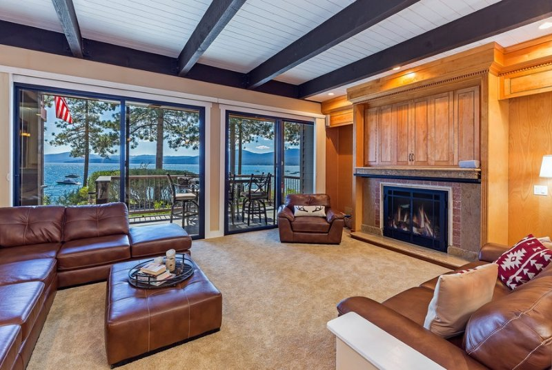 Spacious living room with a gas fireplace and expansive lake views