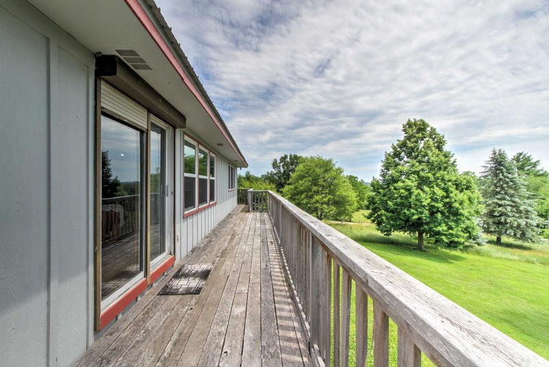 You'll love spending your time on the large wrap-around deck soaking in the fresh air and enjoying the vibrant green views.
