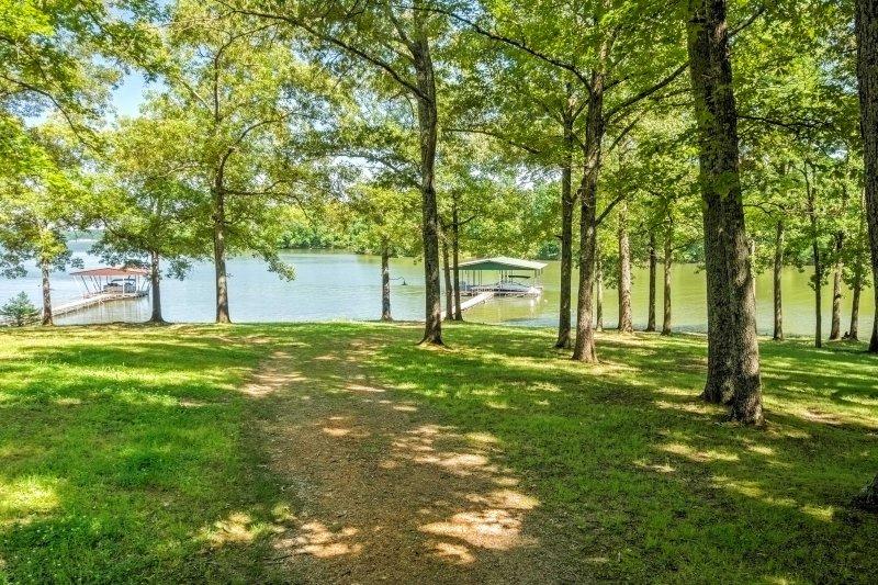 A lake retreat awaits you at this 5-bed, 2-bath vacation rental house