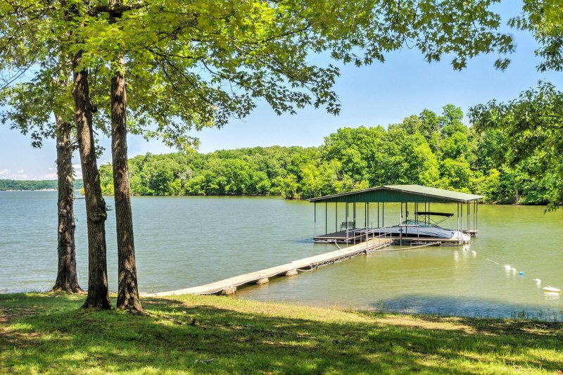 Enjoy this 2-slip boat dock right off your property.