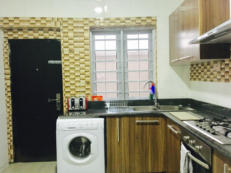 Kitchen equipped with washing machine toaster blender microwave electric kettle etc