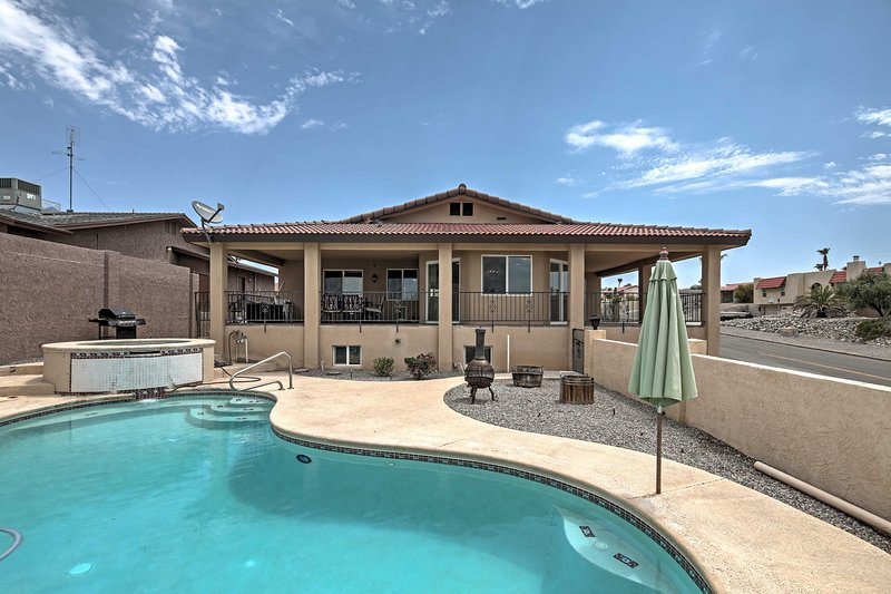 Spend your days lounging poolside during your vacation at this Lake Havasu home!