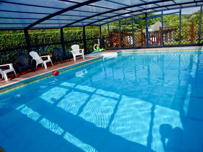OUR TELESCOPIC ENCLOSURE, SWIM AND RELAX WHATEVER THE WEATHER,JUST 4-5 MINUTES WALK TO BEACH & PUBS.