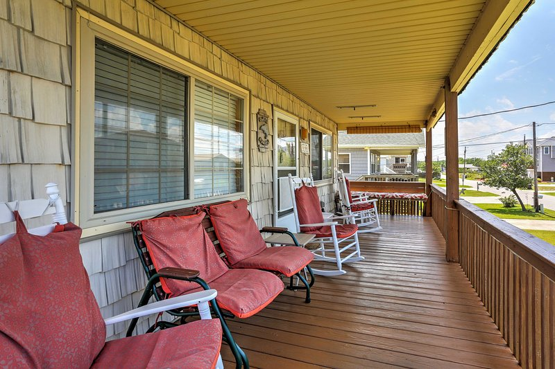 Relax on the porch this 3-bedroom, 2-bath vacation rental in Kill Devil Hills!