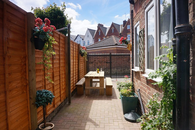 Private secure rear garden with this apartment.