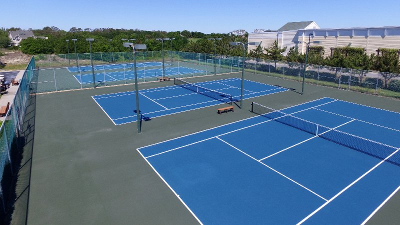Tennis courts at The Currituck Club, lit at night, short walk from house