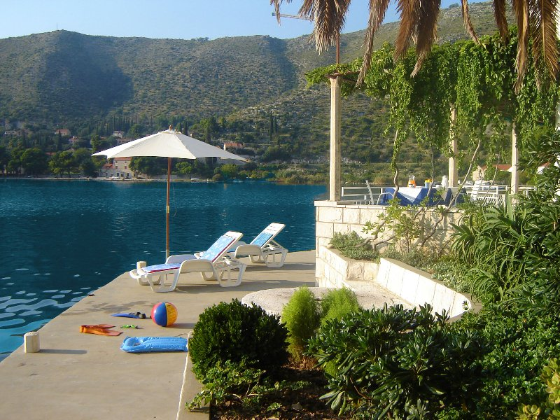 Private waterfront with sunbeds and umbrellas you can use at no additional cost