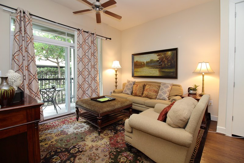 Cozy living room area with Satellite TV service and Wi-Fi Internet at our 1-bed/1-bath apt. in West Houston/Energy Corridor