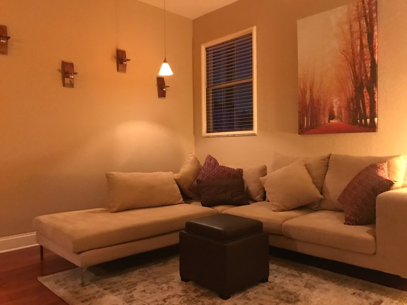 Zen lounge off of kitchen is cozy and another spot perfect to entertain before or after dinner.