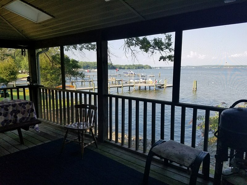Dine Alfresco on the lovely screened porch over looking the bay