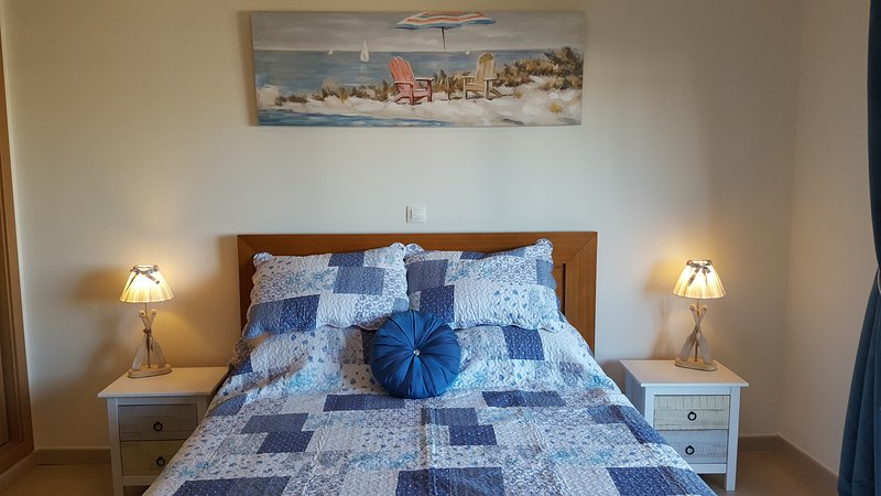 large kingsize bed opening out to a large sunny balcony, with unspoilt views of the marina and town.