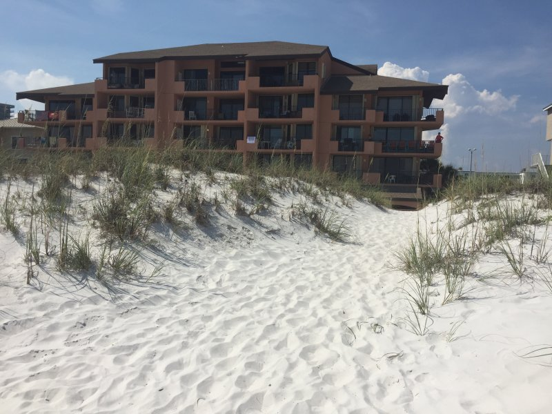 The condo is right on the beach. No roads to cross.