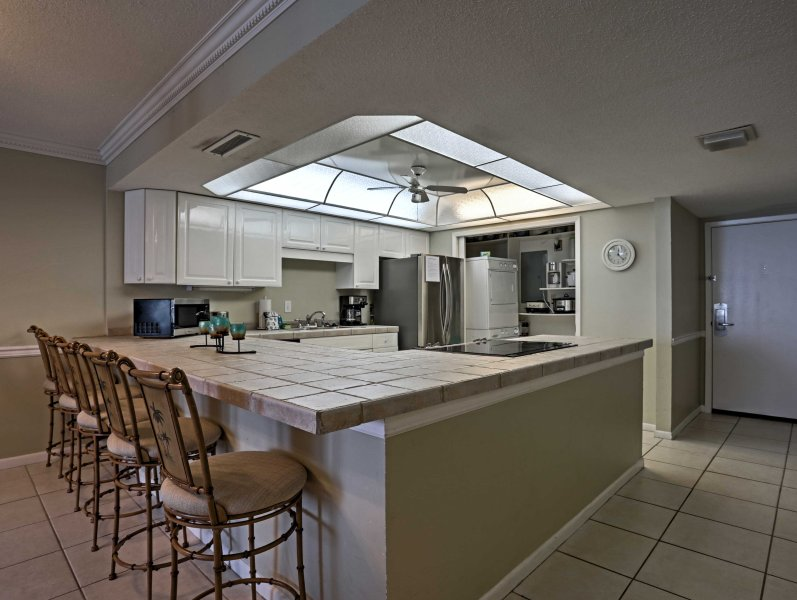 The spacious kitchen is fully equipped with everything you'll need to prepare tasty meals.