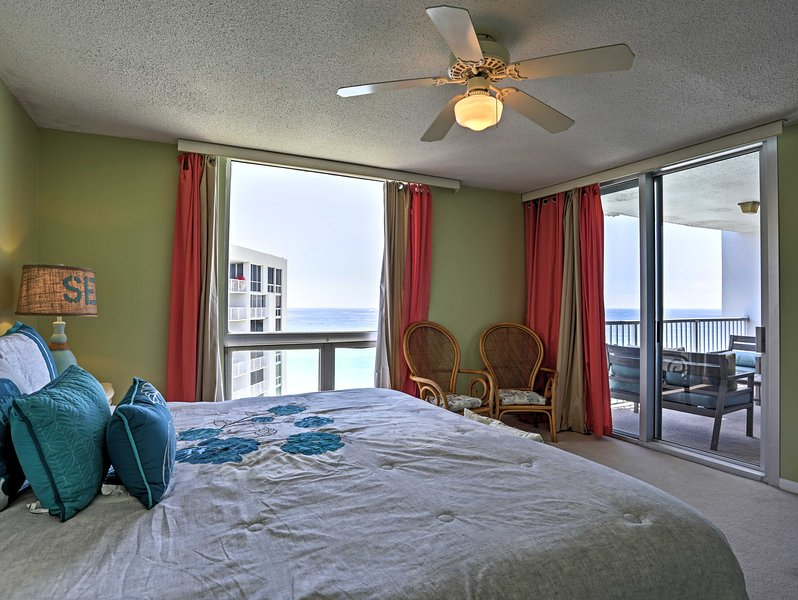 The master bedroom offers a king-sized bed and access to the balcony.