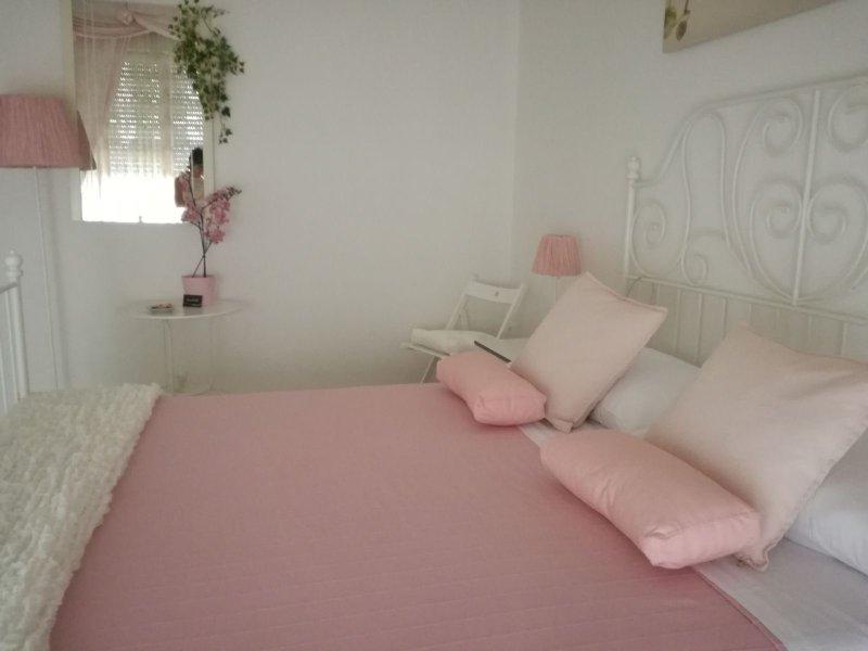 Camera regina rosa