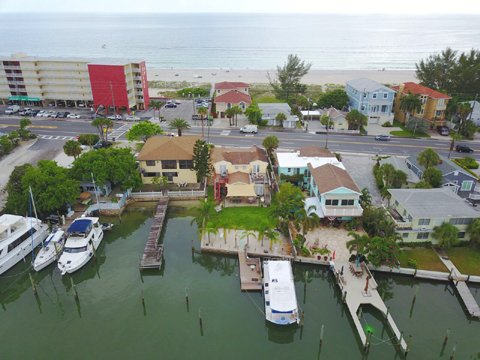 Aerial view of the backyard and the Gulf beach directly across the street