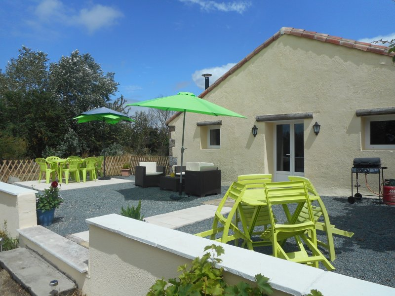 rear of Gite and patio area with BBQ also ramp access for wheelchairs leads to large garden & swings