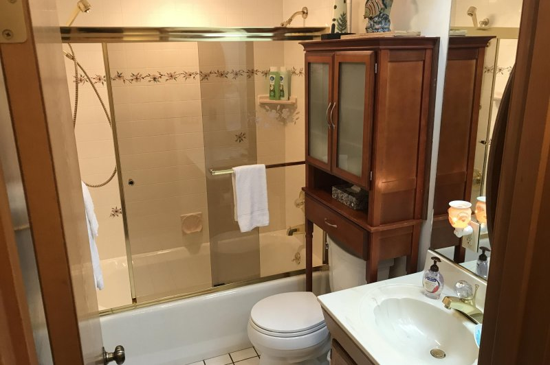 One of two bathrooms has many comforts, including two showerheads