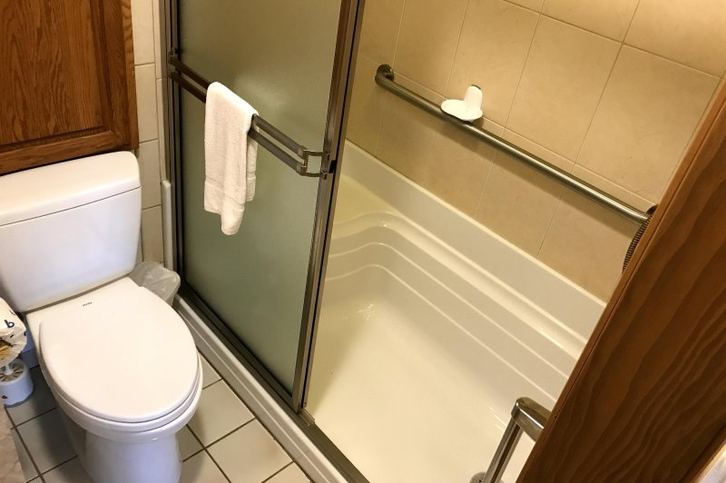 There are grab bars and a seat in the shower
