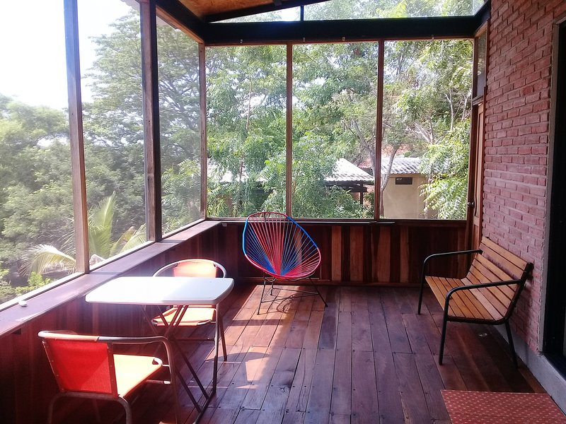Stay with a large terrace, surrounded by forest