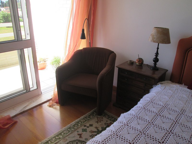 Room full of natural light with access to terrace