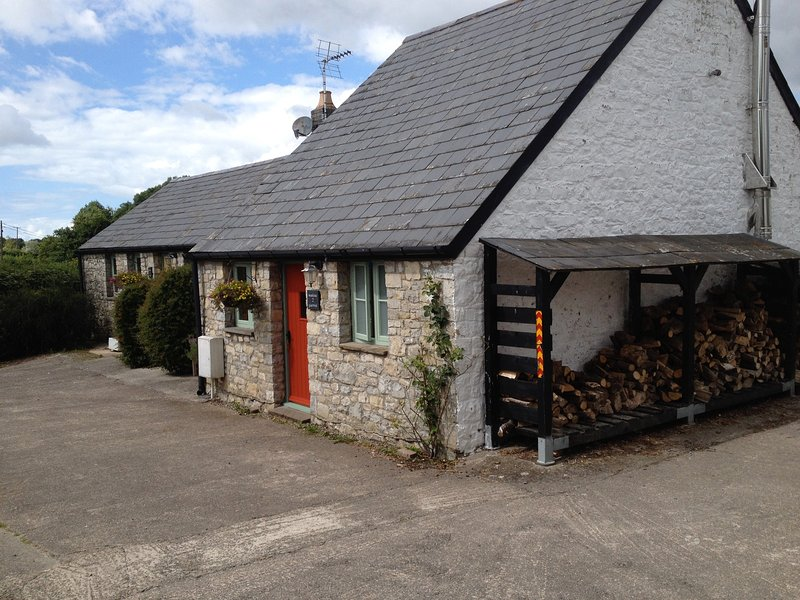 Swallow Cottage exterior . Logs are includes.