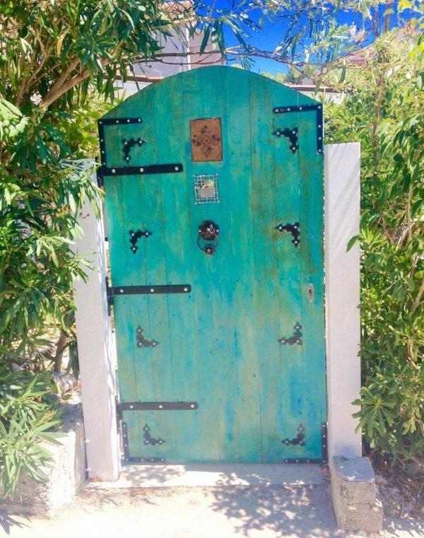 Entrance door (gate) done by Mili Veljkovic, iron bars and colour by artist Ivica Puko Jakšić .