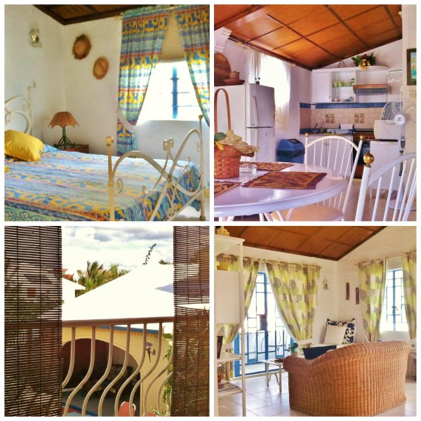 Room with double bed, kitchen and living room overlooking private balcony Bungalow 2nd floor