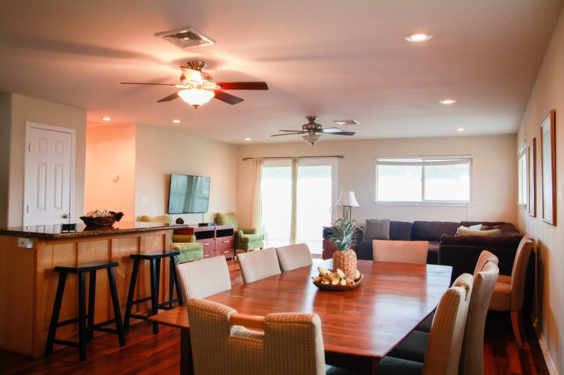 Enjoy eating together as a group at this comfortable dining area.