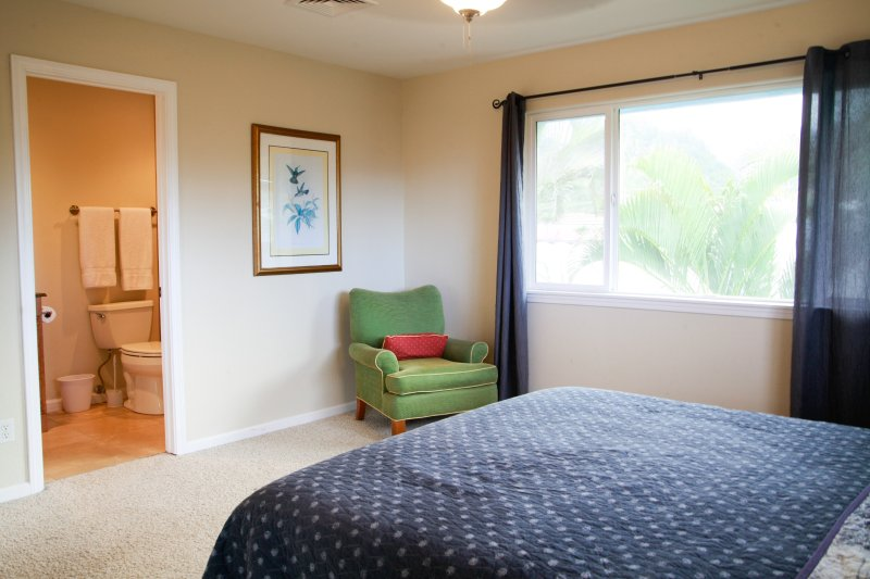 View of bedroom with california king bed.