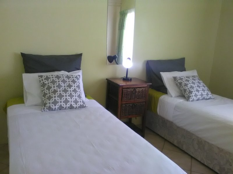 Spacious bedroom with 2 comfy single beds