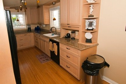 Kitchen w/oven, stove, microwave, full size fridge, coffee maker & toaster oven