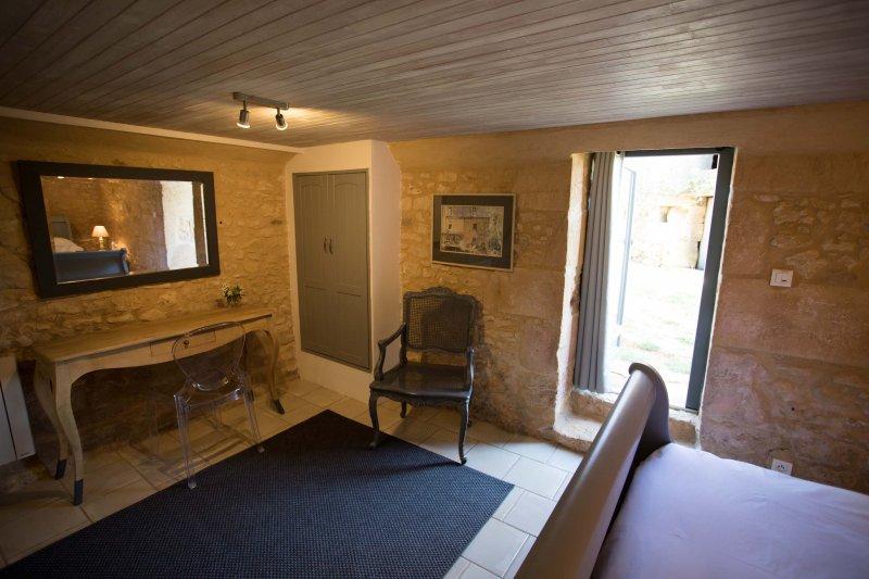 La chambre avec porte terrasse