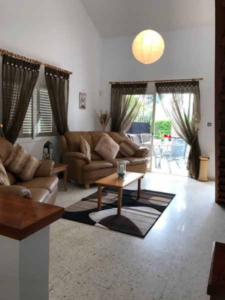 Spacious living area leading out on to furnished sun terrace with private gardens