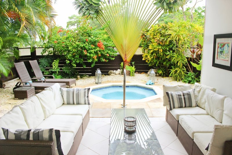 Beautiful secluded tropical garden and covered private terrace