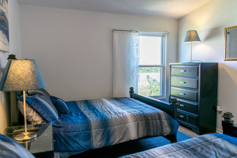 The second bedroom has a fantastic view of the nature preserve.