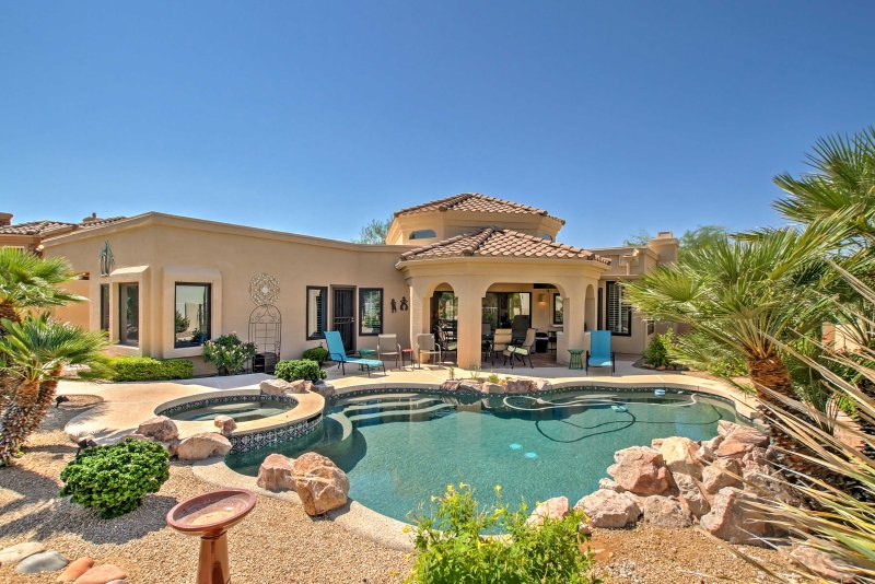 An oasis awaits you in the private backyard.