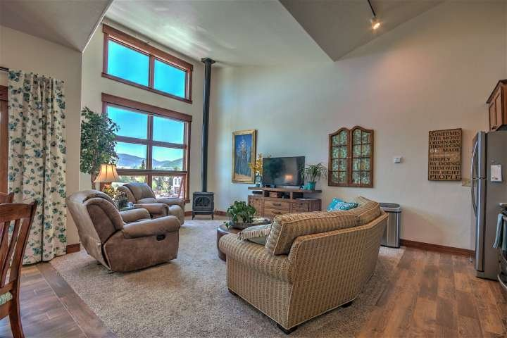 Lots of natural light from the windows, along with a cozy fireplace and big screen TV
