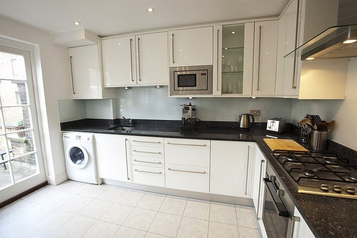 modern clean kitchen with door to a roof tarrace