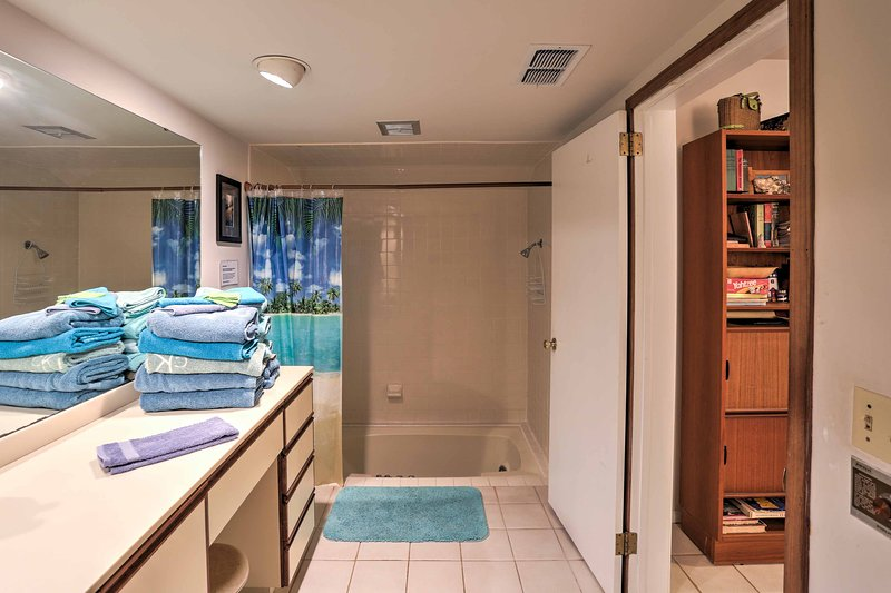 Rinse off before bed in the master en-suite bathroom's shower/tub combo.