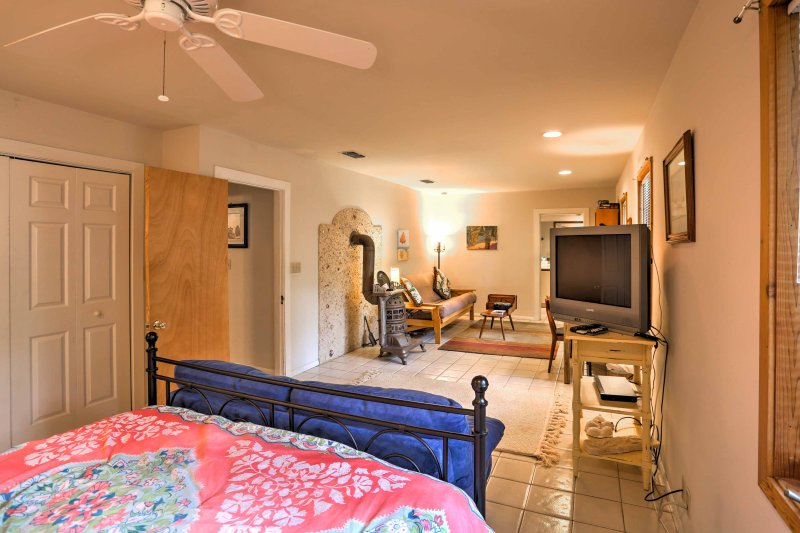 The spacious room also has a flat-screen TV, 2 sofas, and a desk.