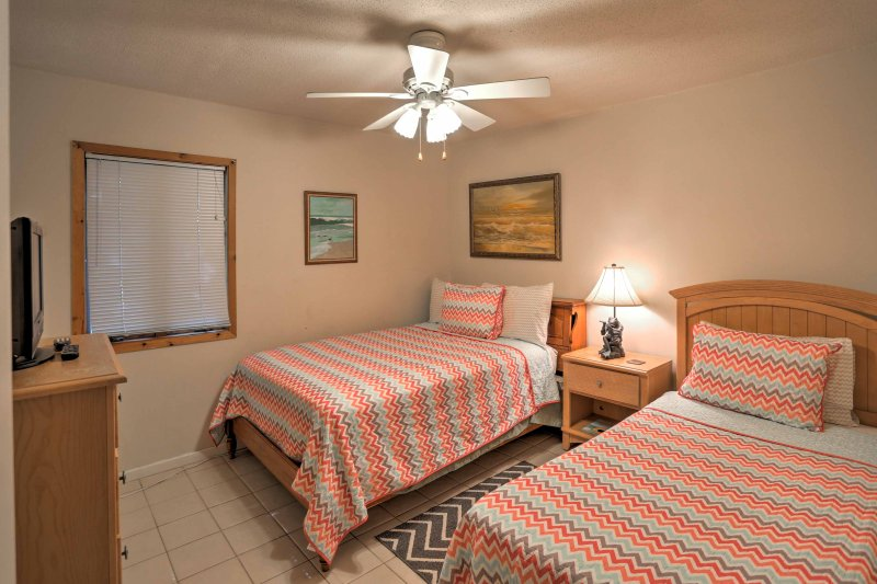 Kids will love the second bedroom with a twin bed, full bed, and flat-screen TV.