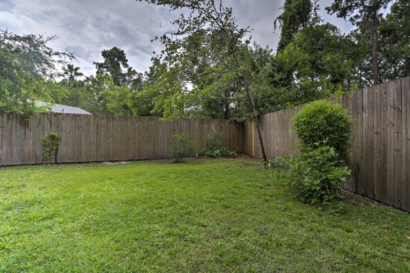 The backyard is perfect for lawn games and is fenced for added privacy.
