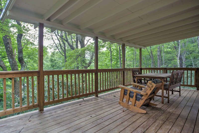 Enjoy fresh morning air as you relax at this vacation rental cabin in Lake Toxaway.
