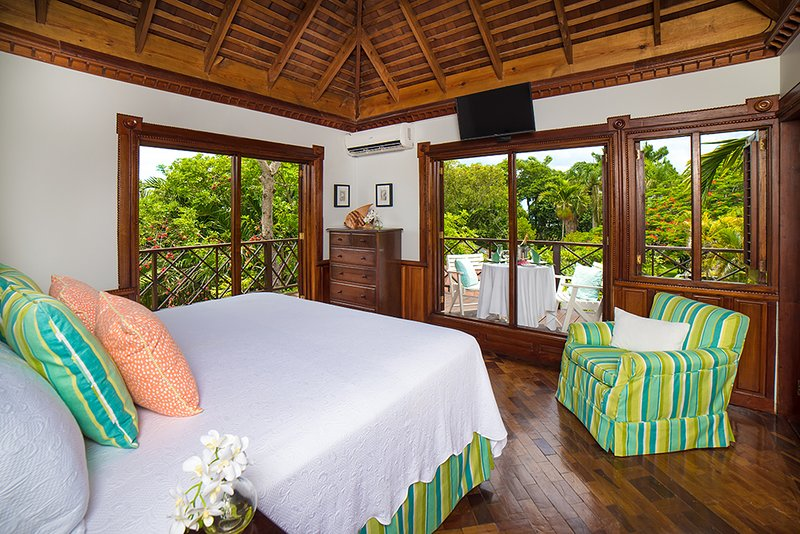 Treetops is also a favorite room for honeymooners.  Louvered doors open to a wrap-around private deck ... and its pink marble shower offers a glorious view of the sea and sunset!