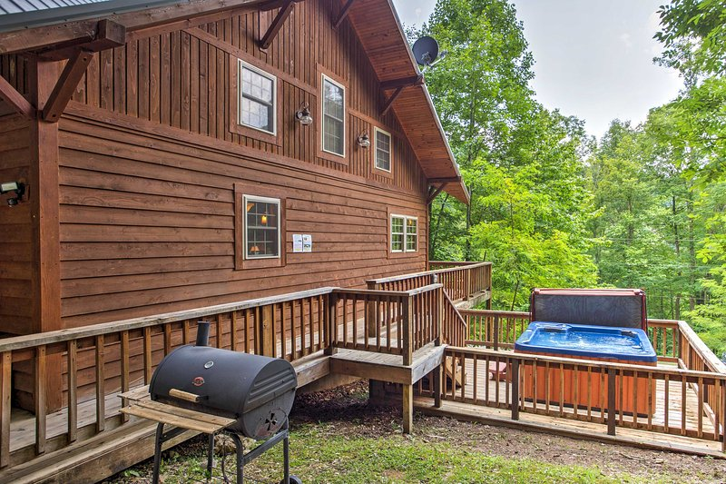Spend your time cooking up meals on the charcoal grill or lounging in the hot tub.