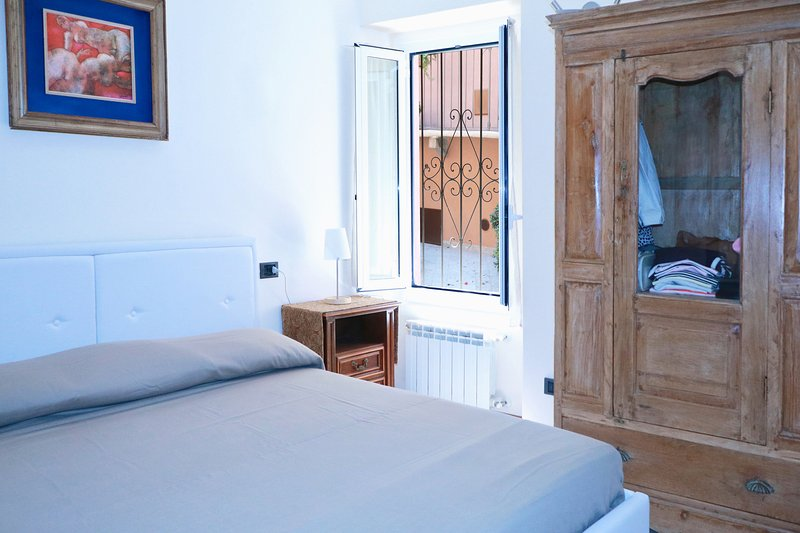 Master bedroom with a double bed
