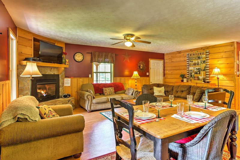 Hardwood floors, a gas fireplace, and plush furnishings fill the interior.