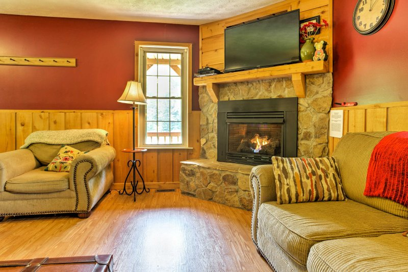 The living room is perfect for watching movies with the group on the flat-screen cable TV.