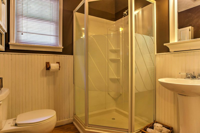 The property's bathroom is complete with single vanity mirror and stand up shower to rinse off.
